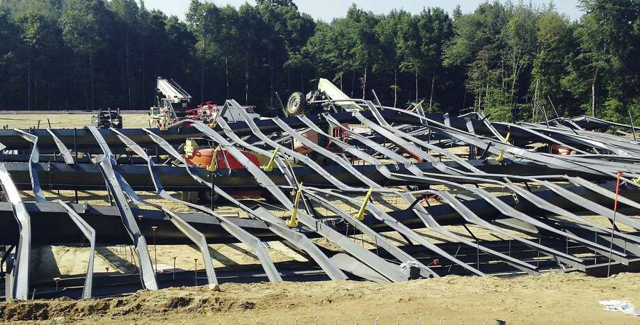 Bent steel covers a construction site where an athletic practice facility being built on the Bryant University campus collapsed Tuesday, Sept. 1, 2015, in Smithfield, R.I. Workers were installing steel beams on a new indoor practice facility  around 8:15 a.m. when the beams collapsed, university spokeswoman Elizabeth OíNeil said. Photo: AP Photo/Jennifer McDermott   / AP
