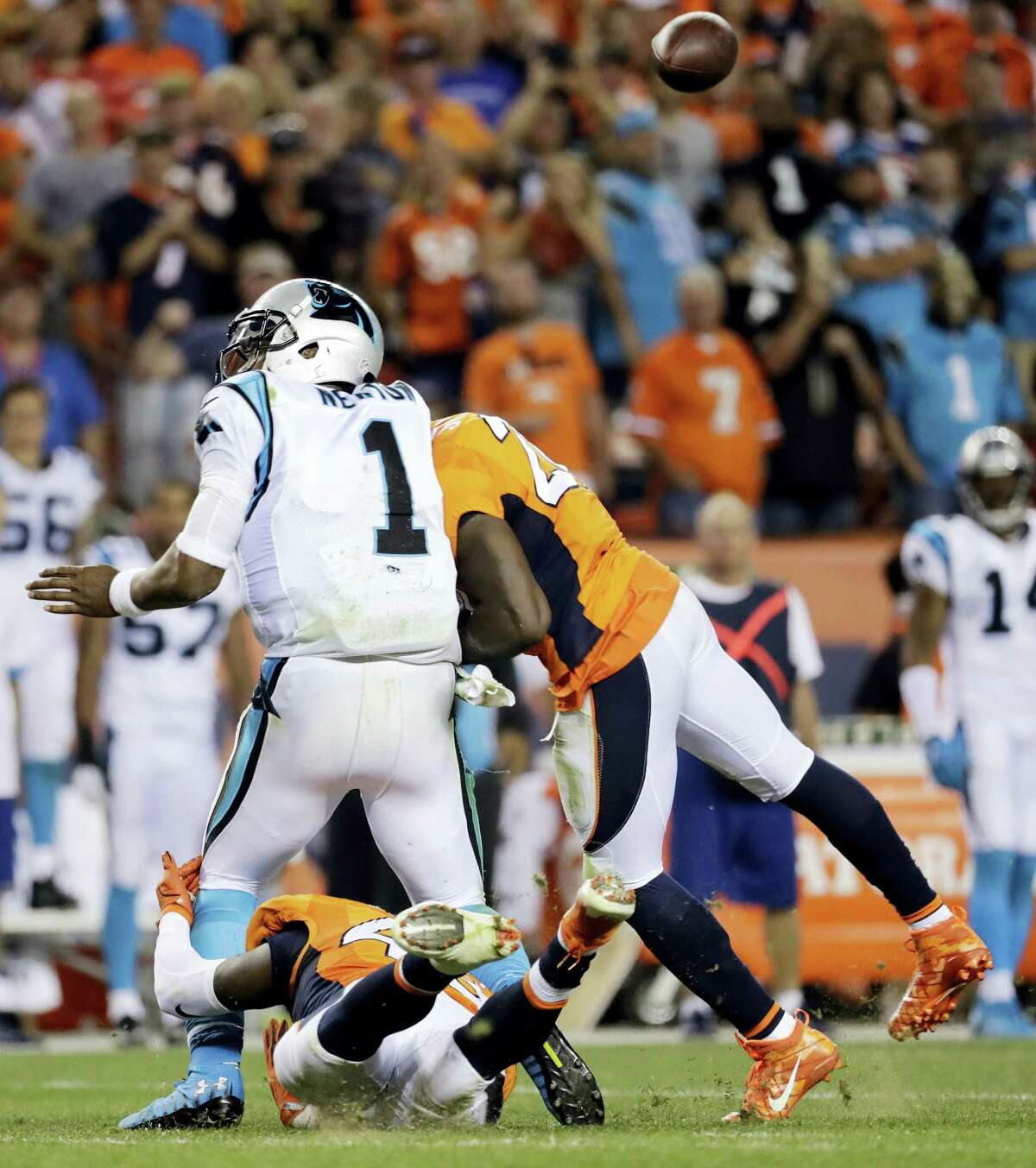 In this Sept. 8, 2016 photo, Denver Broncos free safety Darian Stewart (26) hits Carolina Panthers quarterback Cam Newton (1) late for a penalty during the second half of an NFL football game in Denver.