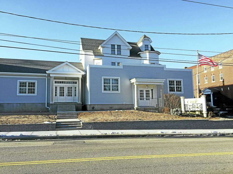 PHOTO BY BEN LAMBERT Cook Funeral Home, located at 82 Litchfield St., Torrington, is in the process of being expanded. Photo: Journal Register Co.