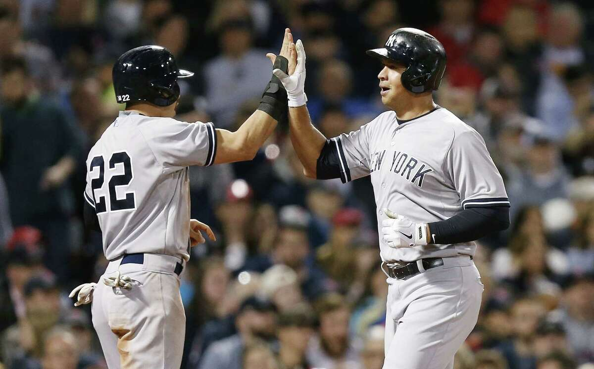 The Yankees' Alex Rodriguez, right, celebrates after scoring with Jacoby Ellsbury on a two-run double by Brian McCann during the third inning on Sunday.