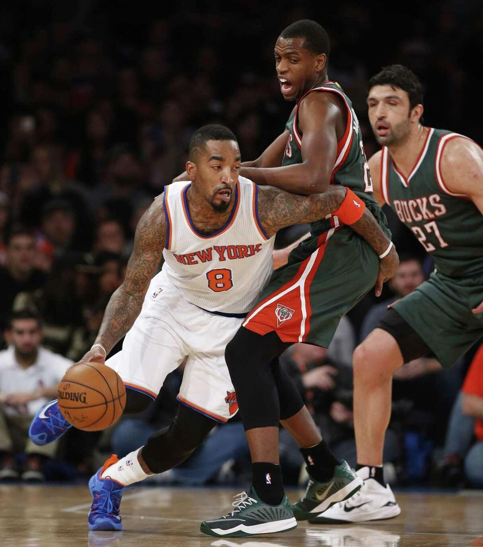 Knicks guard J.R. Smith (8) drives around Bucks forward Khris Middleton (22) during a game earlie this season.