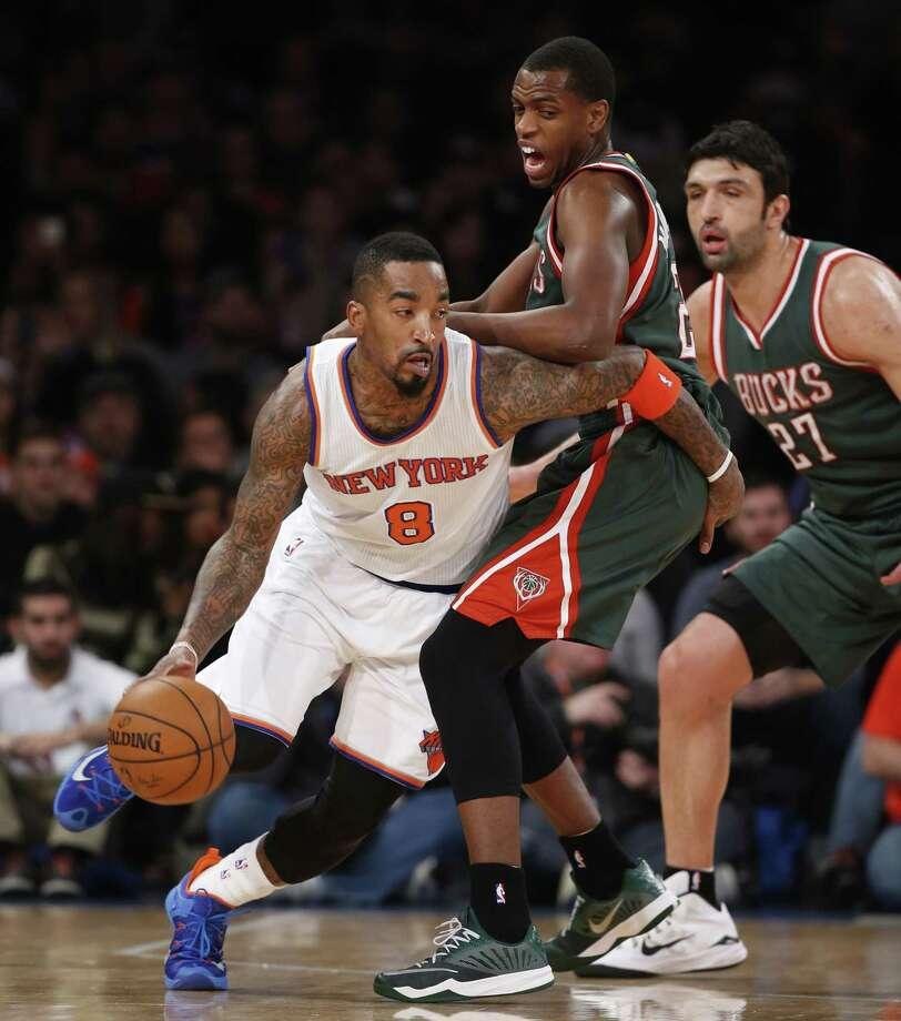 Knicks guard J.R. Smith (8) drives around Bucks forward Khris Middleton (22) during a game earlie this season. Photo: The Associated Press File Photo  / AP