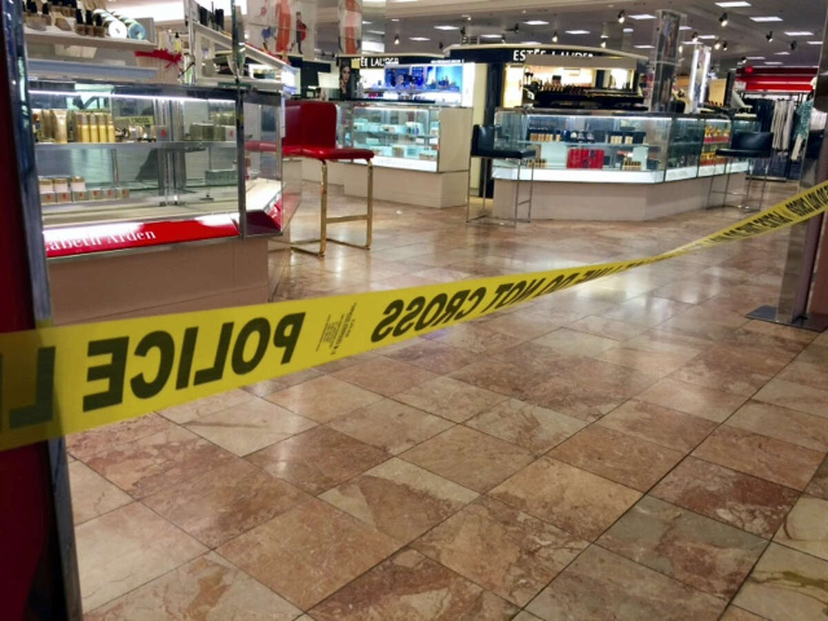 Crime scene tape is seen inside the Macy's at the Silver City Galleria mall in Taunton, Mass., Tuesday, May 10, 2016. Multiple people have been stabbed in separate attacks at the mall and a home in Massachusetts.
