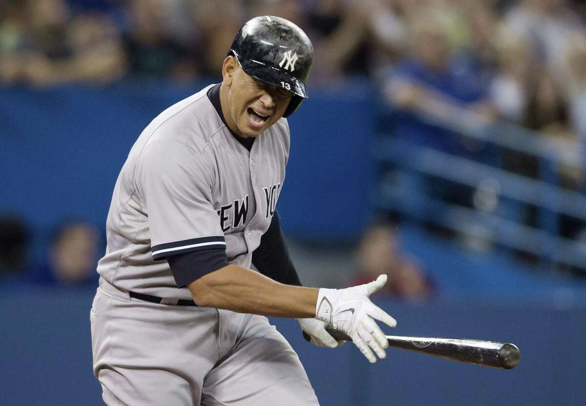 Alex Rodriguez reacts after flying out to right field during sixth inning against the Blue Jays on Monday.