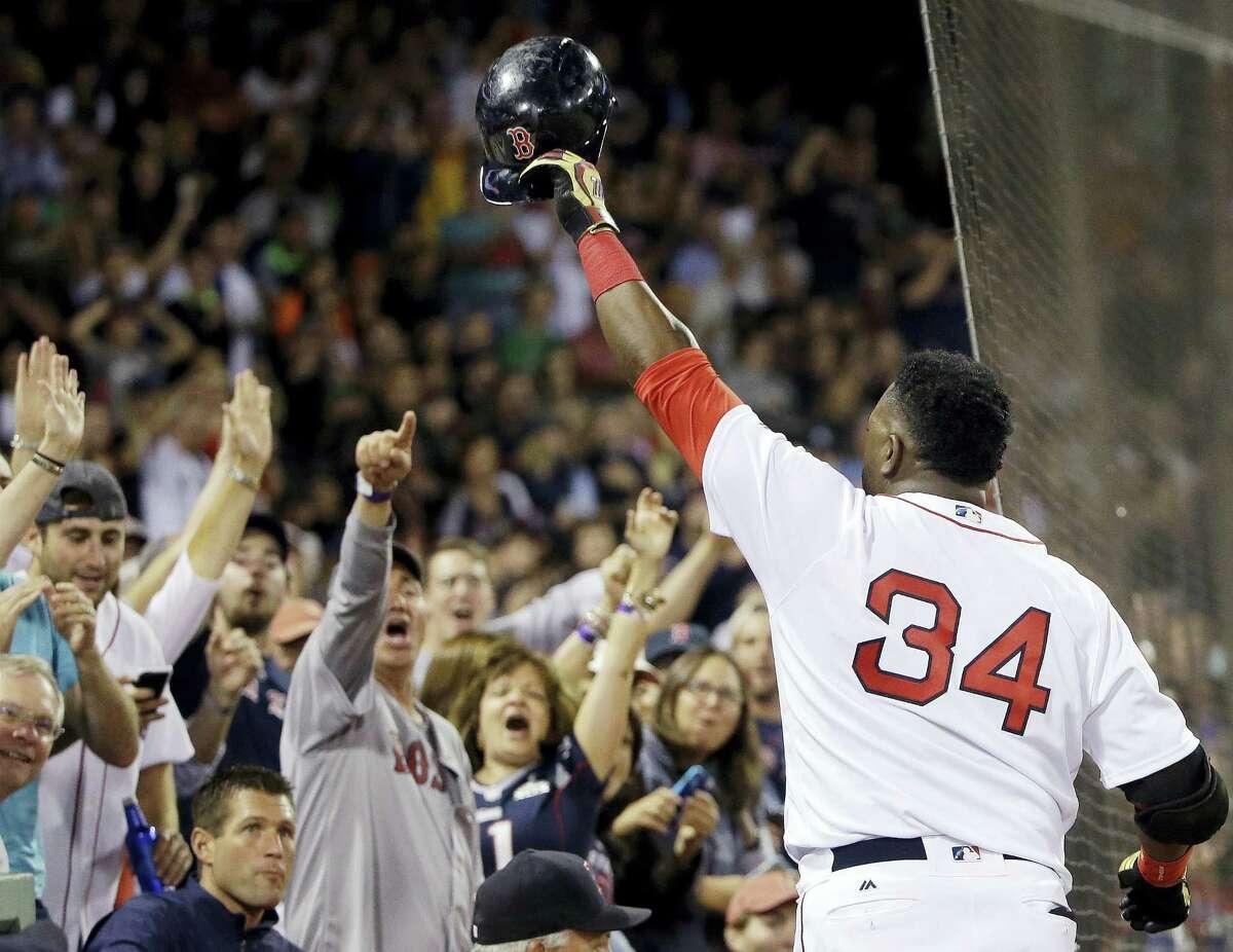 David Ortiz tips his cap to cheering fans on Monday.