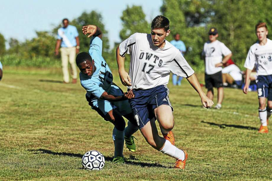 Photo by Marianne Killackey Defender Angel Lopez is part of a good-sized Wildcat defense that balanced out MLC's speed and foot skills for much of Monday's game. Photo: Journal Register Co. / 2015