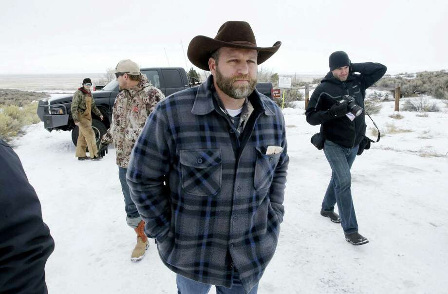 Ammon Bundy, one of the sons of Nevada rancher Cliven Bundy, arrives for an interview at Malheur National Wildlife Refuge, Tuesday, Jan. 5, 2016, near Burns, Ore. Law enforcement had yet to take any action Tuesday against a group numbering close to two dozen, led by Bundy and his brother, who are upset over federal land policy. Photo: AP Photo/Rick Bowmer   / AP