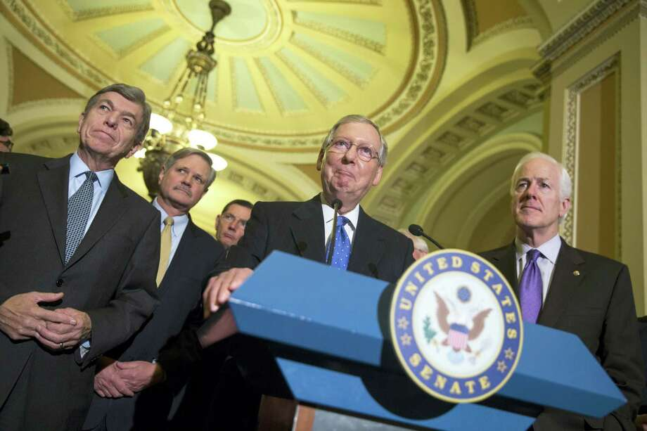 Senate Minority Leader Mitch McConnell of Ky. smiles during a news conference on Capitol Hill in D.C. on Nov. 13, 2014. From left are, sen. Roy Blunt, R-Mo., Sen. John Hoeven, R-N.D., Sen. John Barrasso, R-Wyo., McConnell and Senate Minority Whip  John Cornyn of Texas. Photo: AP Photo/Evan Vucci  / AP