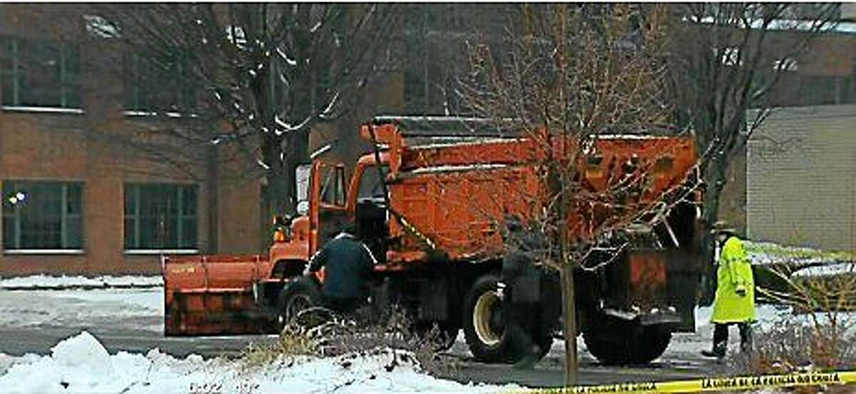 Torrington police are investigating after a man was fatally struck by a city plow truck while jogging Sunday morning. (Photo via screenshot from WTNH.com)