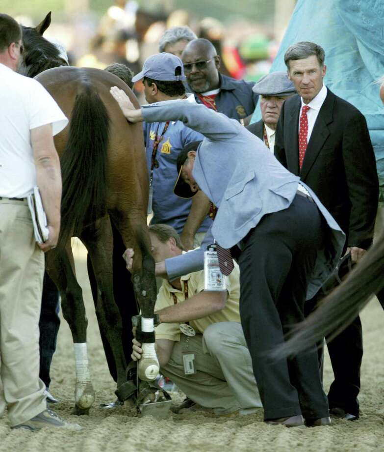 In this 2006 photo, Barbaro's right rear leg is stabilized on the track after he broke down near the start of the Preakness Stakes. Despite the efforts of an esteemed veterinarian, the unrestricted financial backing of the horse's owners and the outpouring of love from racing fans around the world, the injuries Barbaro sustained at the Preakness ultimately led to his death. Photo: The Associated Press File Photo  / Copyright 2016 The Associated Press. All rights reserved. This material may not be published, broadcast, rewritten or redistribu