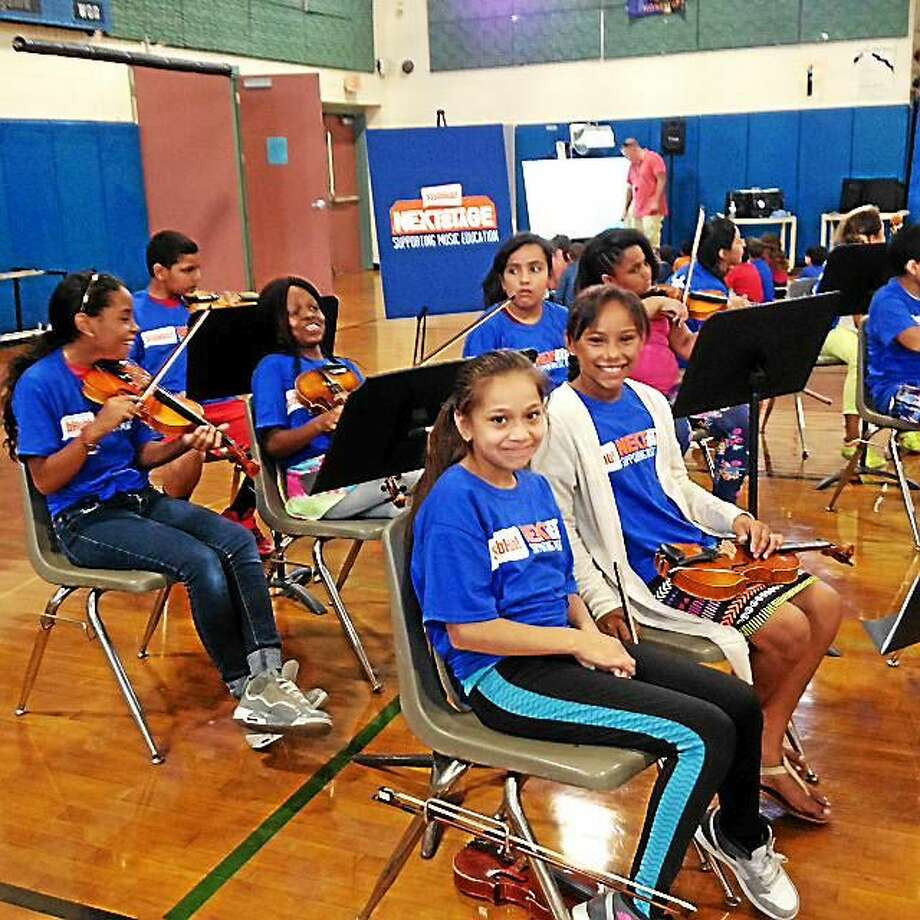 Students at Vogel-Wetmore were surprised on Tuesday with 25 new musical instruments donated by StubHub in partner with The Mr. Hollandís Opus Foundation. Photo: Amanda Webster — The Register Citizen