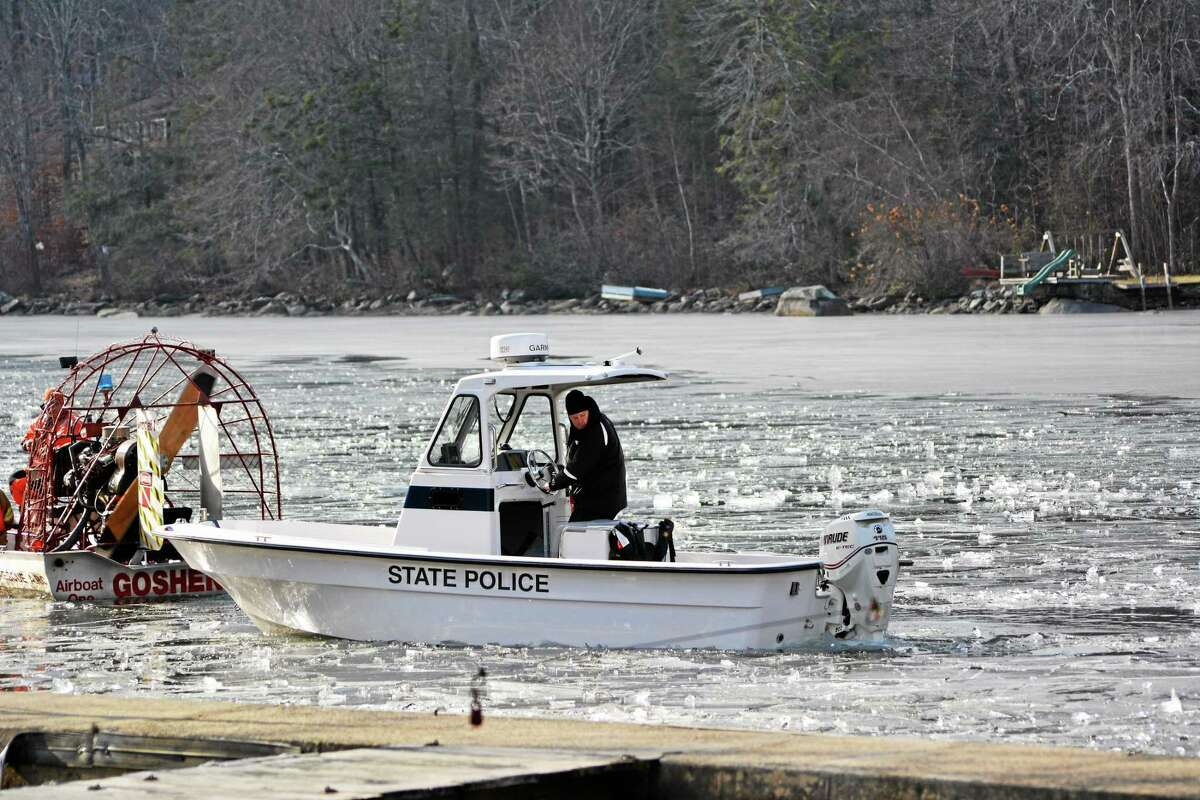 An airboat from Goshen Fire Department breaks up ice on West Hill Pond so a state police boat could search the area for a missing kayaker.