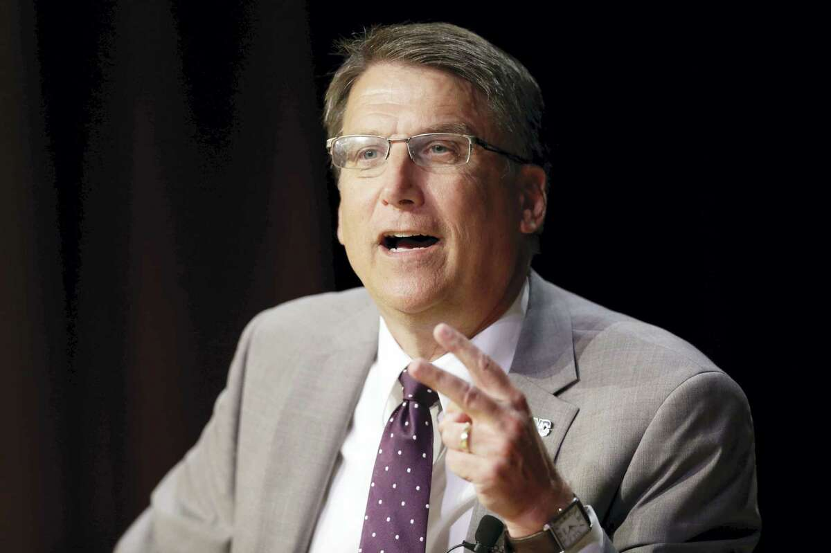"""North Carolina Gov. Pat McCrory makes remarks concerning House Bill 2 while speaking during a government affairs conference in Raleigh, N.C., Wednesday, May 4, 2016. North Carolina's """"bathroom law"""" limits protections to LGBT people, violates federal civil rights laws and can't be enforced, the U.S. Justice Department said Wednesday, putting the state on notice that it is in danger of being sued and losing hundreds of millions of dollars in federal funding."""
