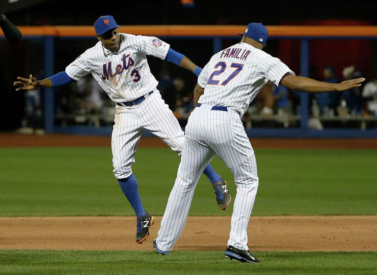 New York right fielder Curtis Granderson, left, celebrates with closer Jeurys Familia after the Mets defeated the Kansas City Royals in Game 3 of the World Series on Friday at Citi Field.