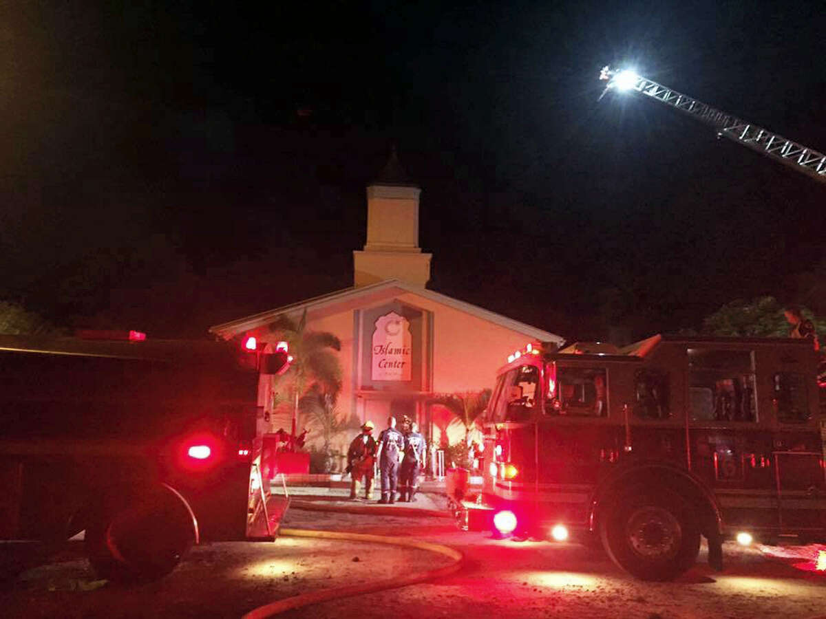 In this photo provided by the St. Lucie Sheriff's Office, firefighters work at the scene of a fire at the Islamic Center of Fort Pierce on Sept. 12, 2016 in Fort Pierce, Fla.