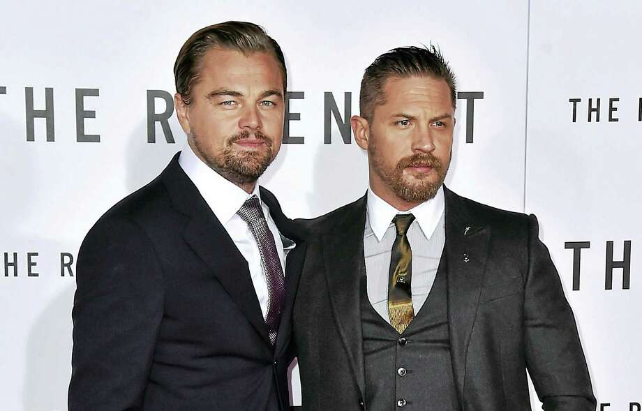 """Leonardo DiCaprio, left, and Tom Hardy arrive Dec. 16, 2015, at the world premiere of """"The Revenant"""" at the TCL Chinese Theatre in Los Angeles. Photo: Photo By Jordan Strauss/Invision/AP  / Invision"""