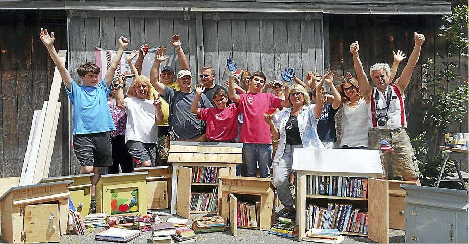 Library builders celebrate their accomplishments. Pictured are Little Free Library Steward Rose Buckens, third from right, and Harvey Hubbell, far right, and all the volunteers at the box-building workshop at Hubbell's farm on July 2. Photo: Contributed Photo