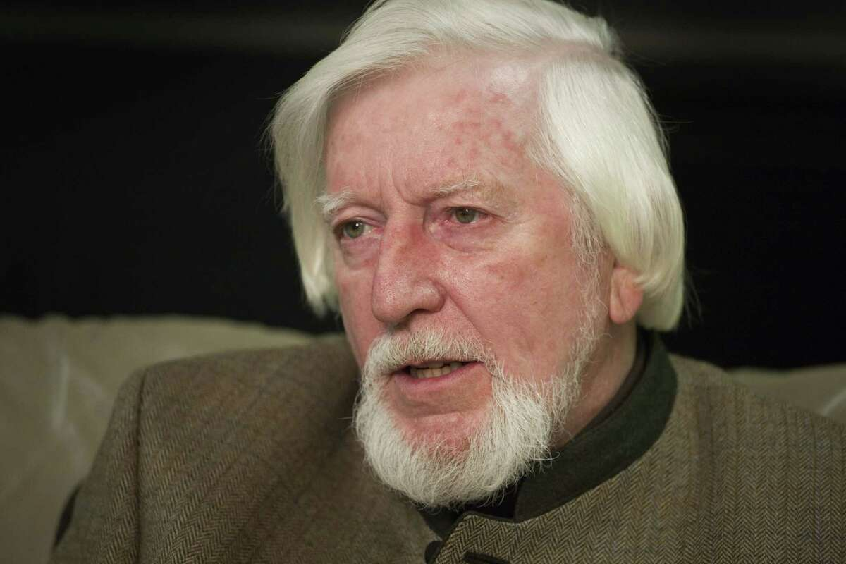 In this 2008 file photo, puppeteer Caroll Spinney, who voices Big Bird and Oscar the Grouch, is interviewed during a break from taping an episode of Sesame Street in New York.