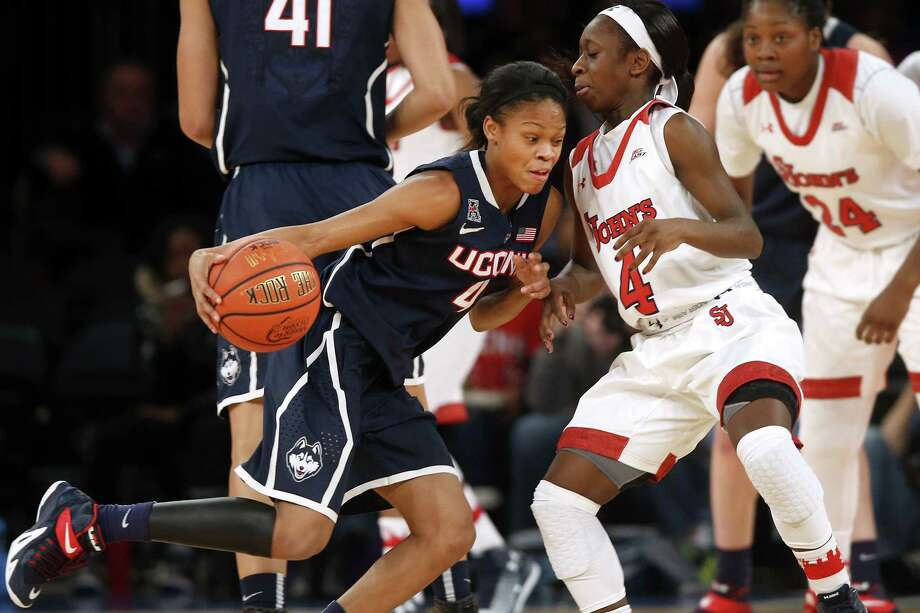 UConn's Moriah Jefferson, left, drives against St. John's Aaliyah Lewis during the first half Sunday. Photo: Jason DeCrow — The Associated Press  / FR103966 AP