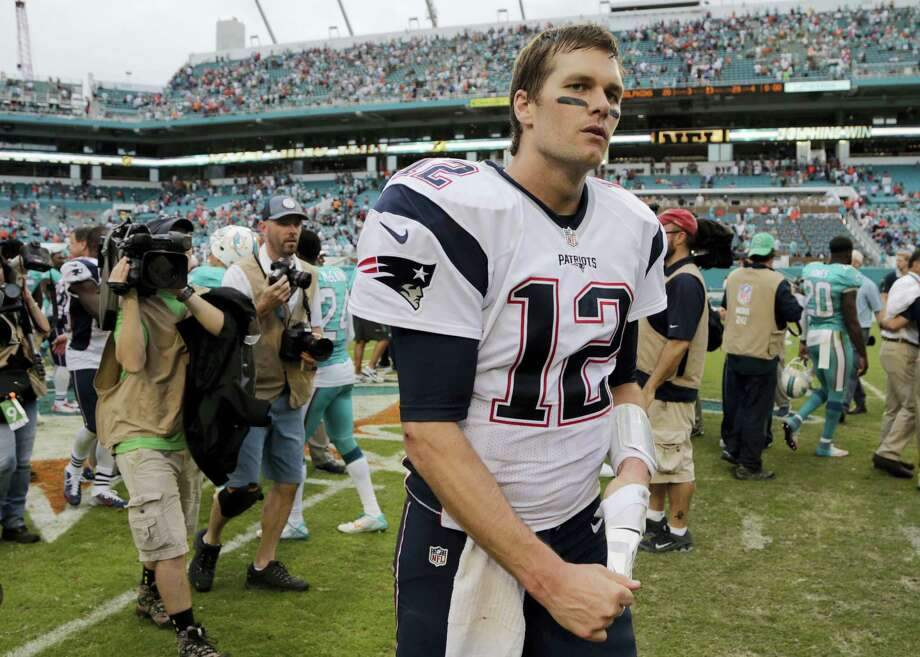 Patriots quarterback Tom Brady (12) leaves the field after Sunday's loss to the Dolphins in Miami. Photo: The Associated Press  / AP