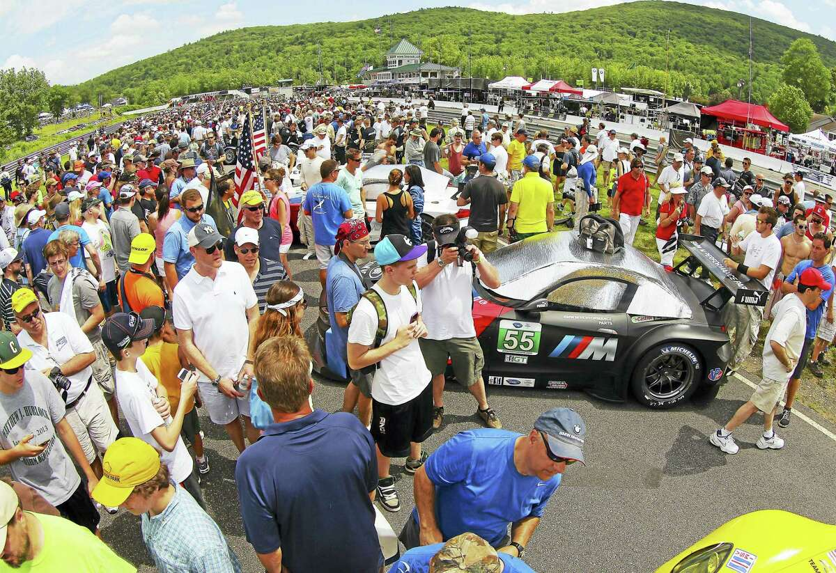 """A typical pre-race """"Grid Fan Walk"""" is shown during the 2013 Pirelli World Challenge at Lime Rock Park in Lakeville."""