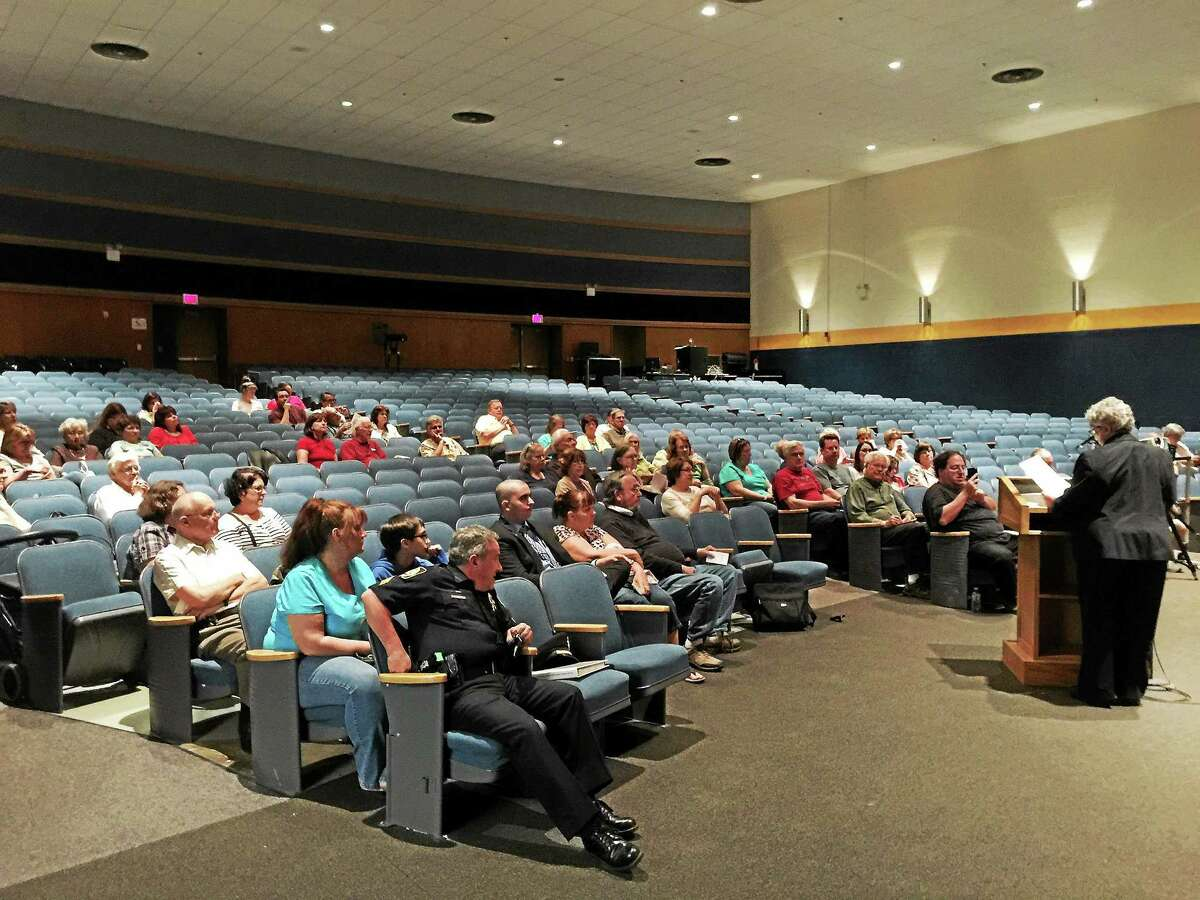 Winsted residents considered, but ultimately decided against, reducing the prospective town budget for 2015-16 at a meeting Monday evening.