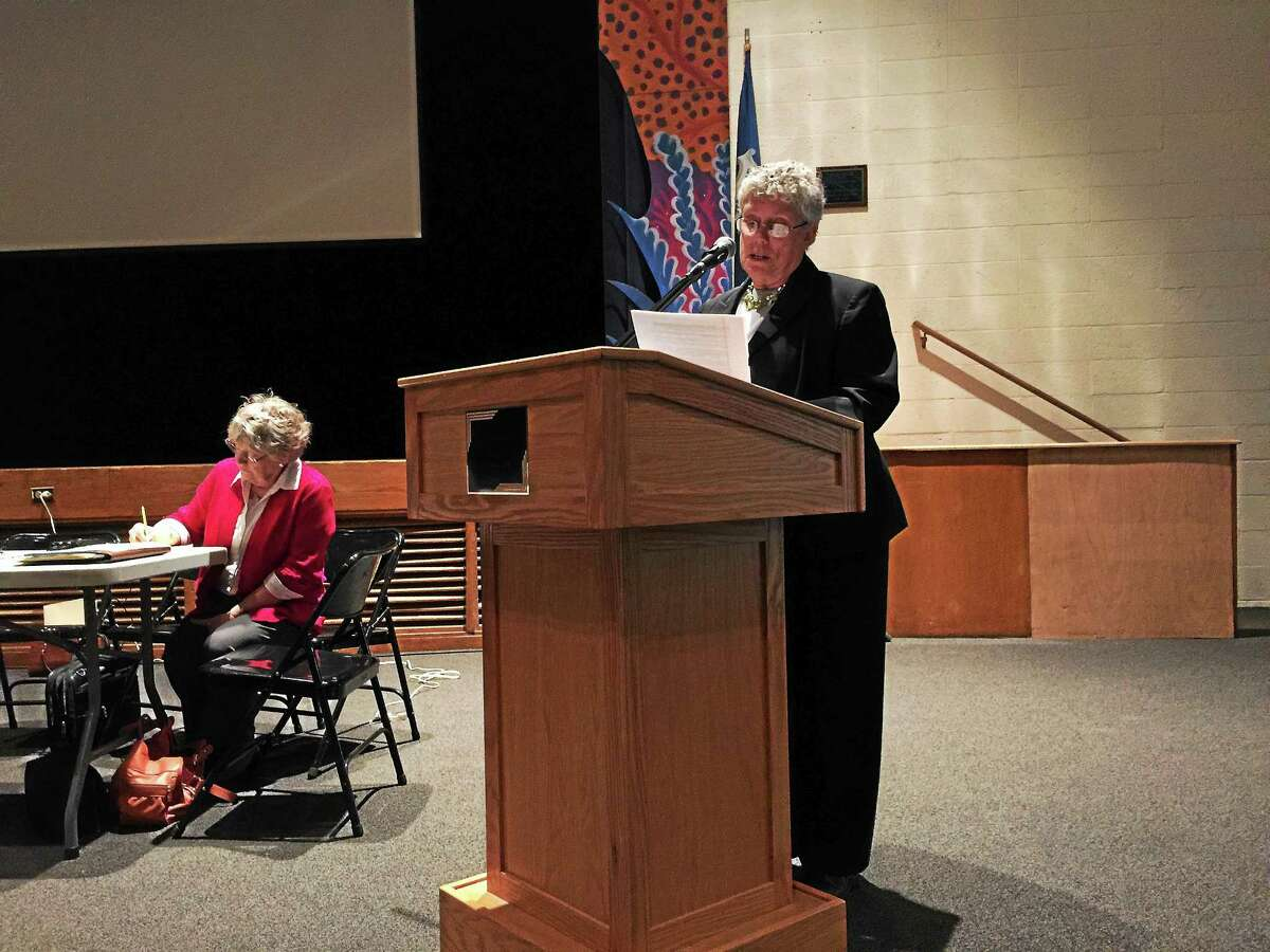 Judy Dixon, moderator, leads Winsted residents in considering, reducing the prospective town budget for 2015-16 Monday evening.