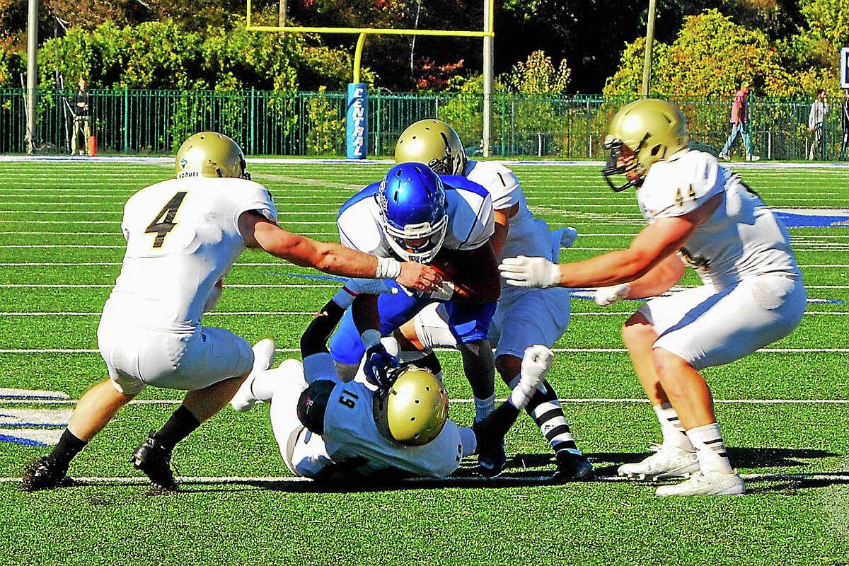 CCSU PhotoTorrington High School alum Willie Quarles rushes against Bryant.
