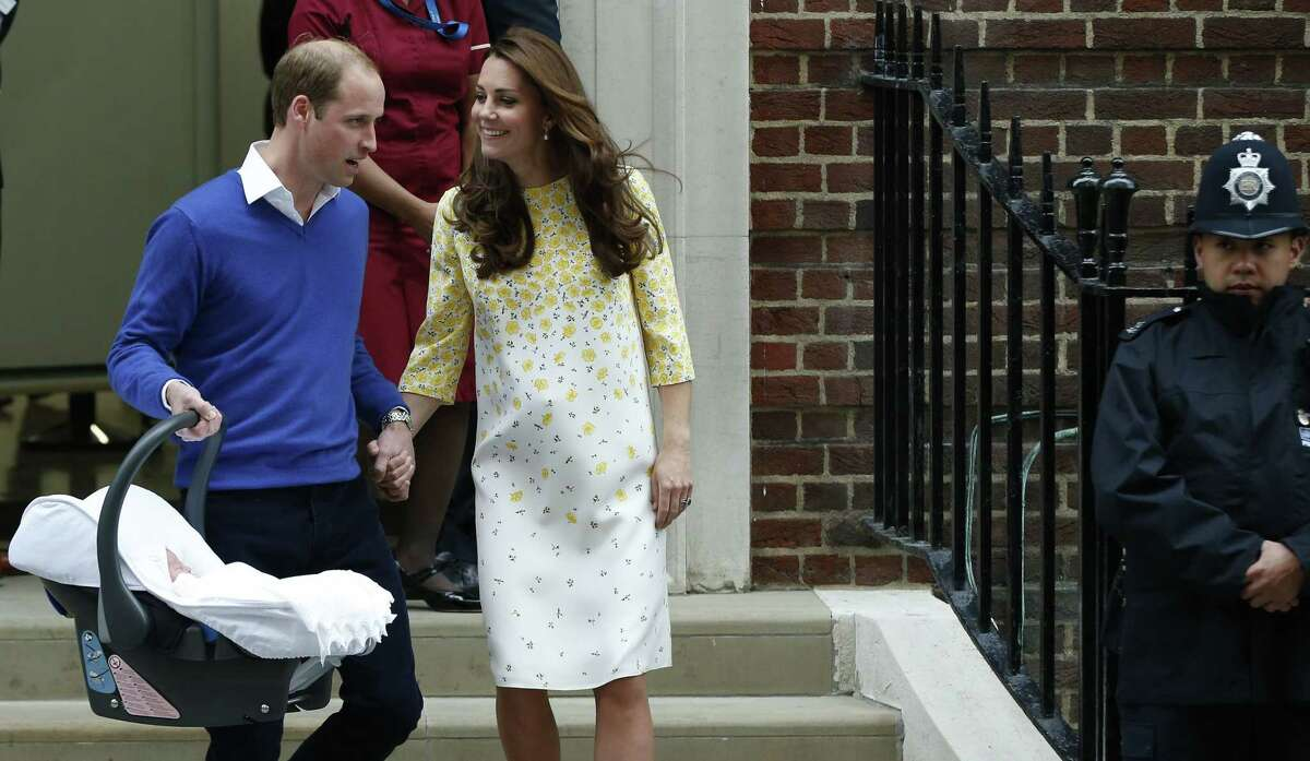 Britain's Prince William, left, and Kate, Duchess of Cambridge, hold their newborn daughter as they as they leave St. Mary's Hospital in London Saturday.