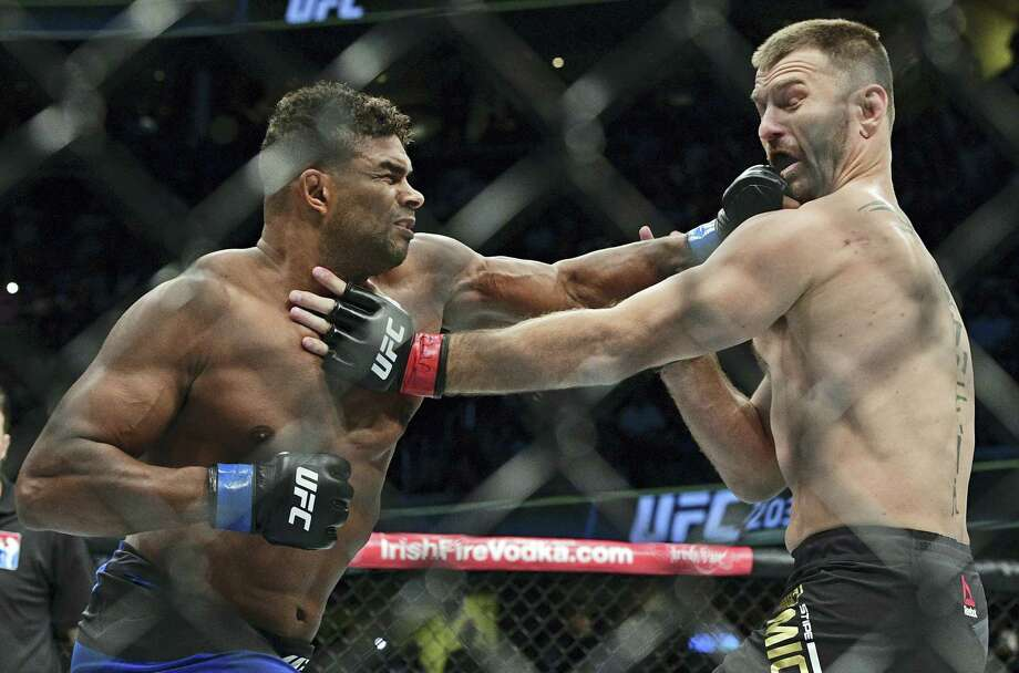 Alistair Overeem, left, from the Netherlands, punches Stipie Miocic during a heavyweight title bout at UFC 203 on Sept. 10, 2016 in Cleveland. Photo: AP Photo/David Dermer  / FR171035 AP