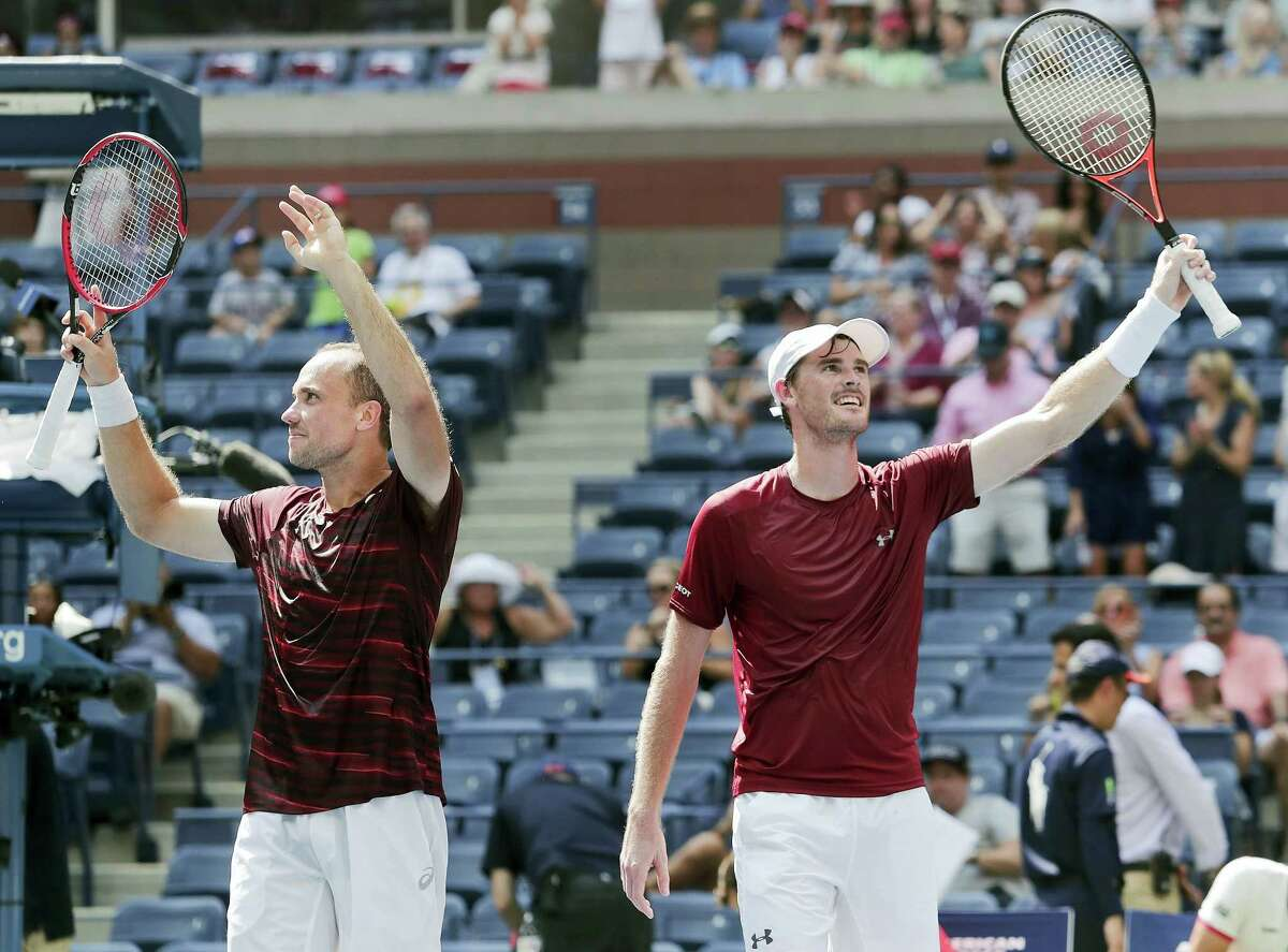 Bruno Soares, of Brazil, left, and Jamie Murray, of the United Kingdom, celebrate after winning the men's doubles final of the U.S. Open tennis tournament on Sept. 10, 2016 in New York.