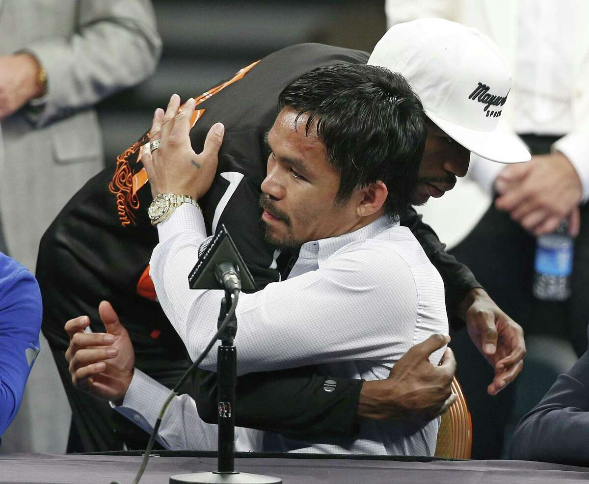 Manny Pacquiao is embraced by Floyd Mayweather Jr. during a press conference following their welterweight title fight on Saturday, May 2, 2015 in Las Vegas. Mayweather defeated Pacquiao in a unanimous decision.