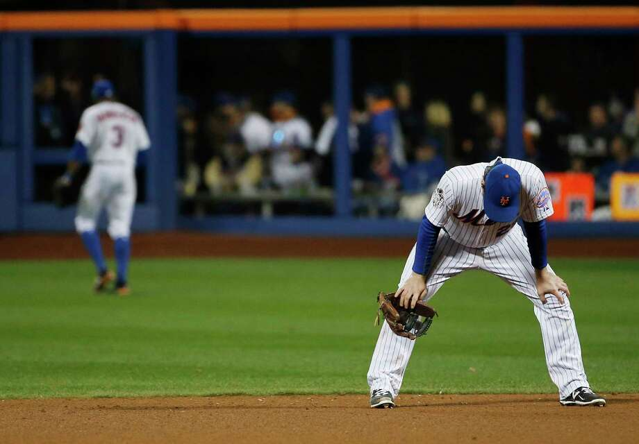 The Mets' Daniel Murphy reacts after missing a ball hit by the Royals' Mike Moustakas during the eighth inning of Game 4 of the World Series Saturday. Photo: Matt Slocum — The Associated Press  / AP