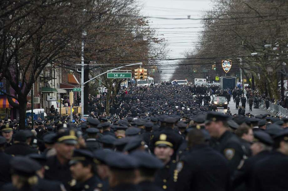 Police officers from across the country gather for the funeral of New York Police Department Officer Wenjian Liu at Aievoli Funeral Home Sunday. Photo: Associated Press  / FR170537 AP