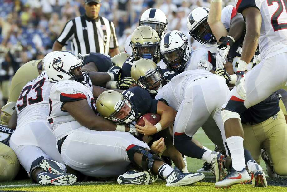 Navy quarterback Will Worth, center, falls into the end zone for a touchdown in the second half of an NCAA college football game against Connecticut in Annapolis, Md. on Sept. 10, 2016. Navy won 28-24. Photo: AP Photo/Patrick Semansky  / Copyright 2016 The Associated Press. All rights reserved.