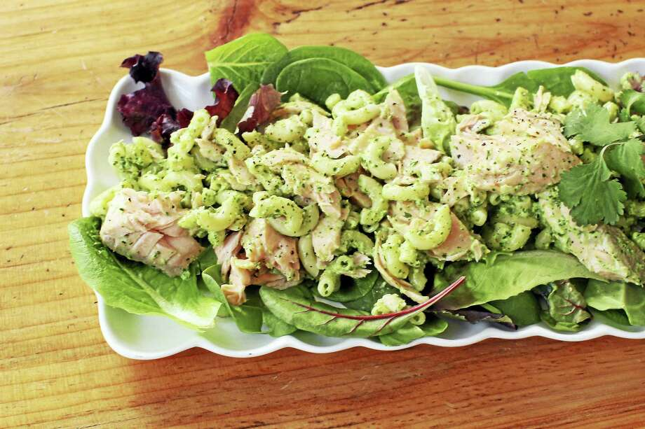 This delicious spring dish is easy to assemble and travels well, making it perfect for packed lunches and picnics. It also can be prepped in advance by poaching the fish and cooking the pasta the night before. Photo: Matthew Mead — The Associated Press  / FR170582 AP