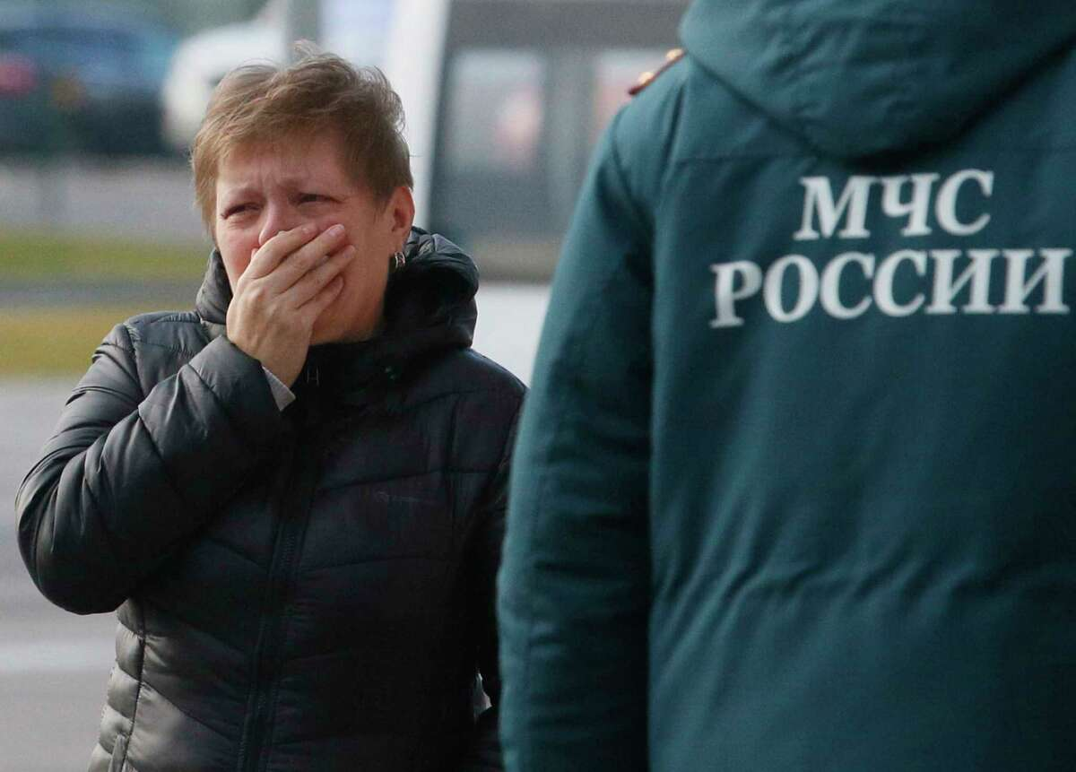 A relative of the victims of a Russian airliner with 217 passengers and seven crew aboard has crashed, reacts at Pulkovo airport in St.Petersburg, Russia, Saturday, Oct. 31, 2015. Russia's civil air agency is expected to have a news conference shortly to talk about the Russian Metrojet passenger plane that Egyptian authorities say has crashed in Egypt's Sinai peninsula.