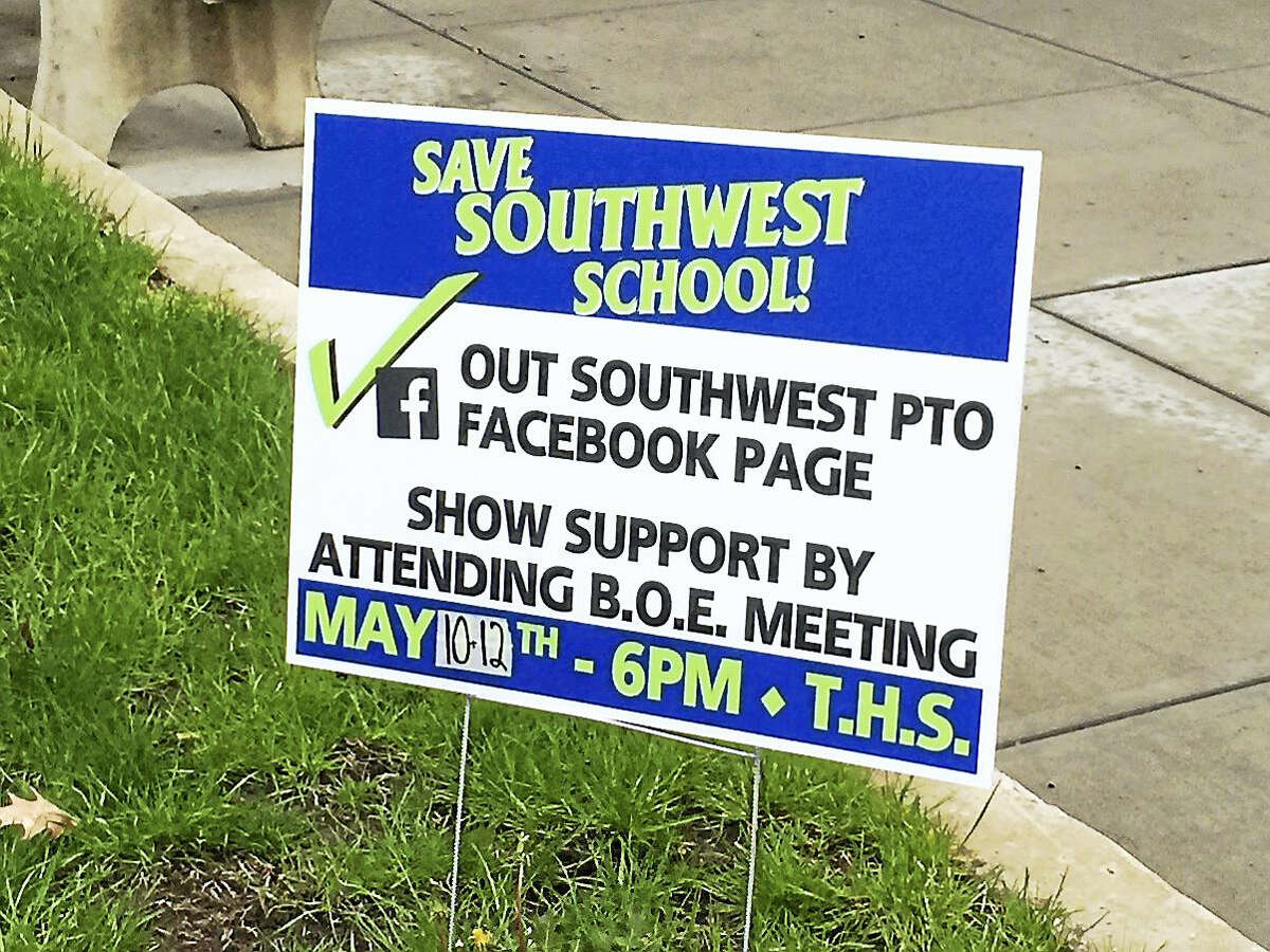 A sign urging residents to support keeping Southwest School open, as displayed recently on the lawn of City Hall in Torrington.