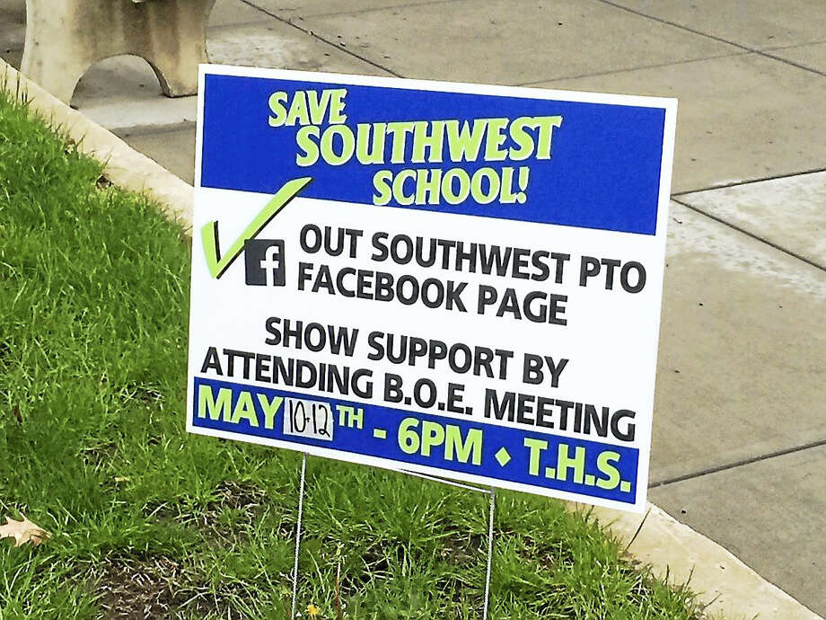 A sign urging residents to support keeping Southwest School open, as displayed recently on the lawn of City Hall in Torrington. Photo: BEN LAMBERT — THE REGISTER CITIZEN