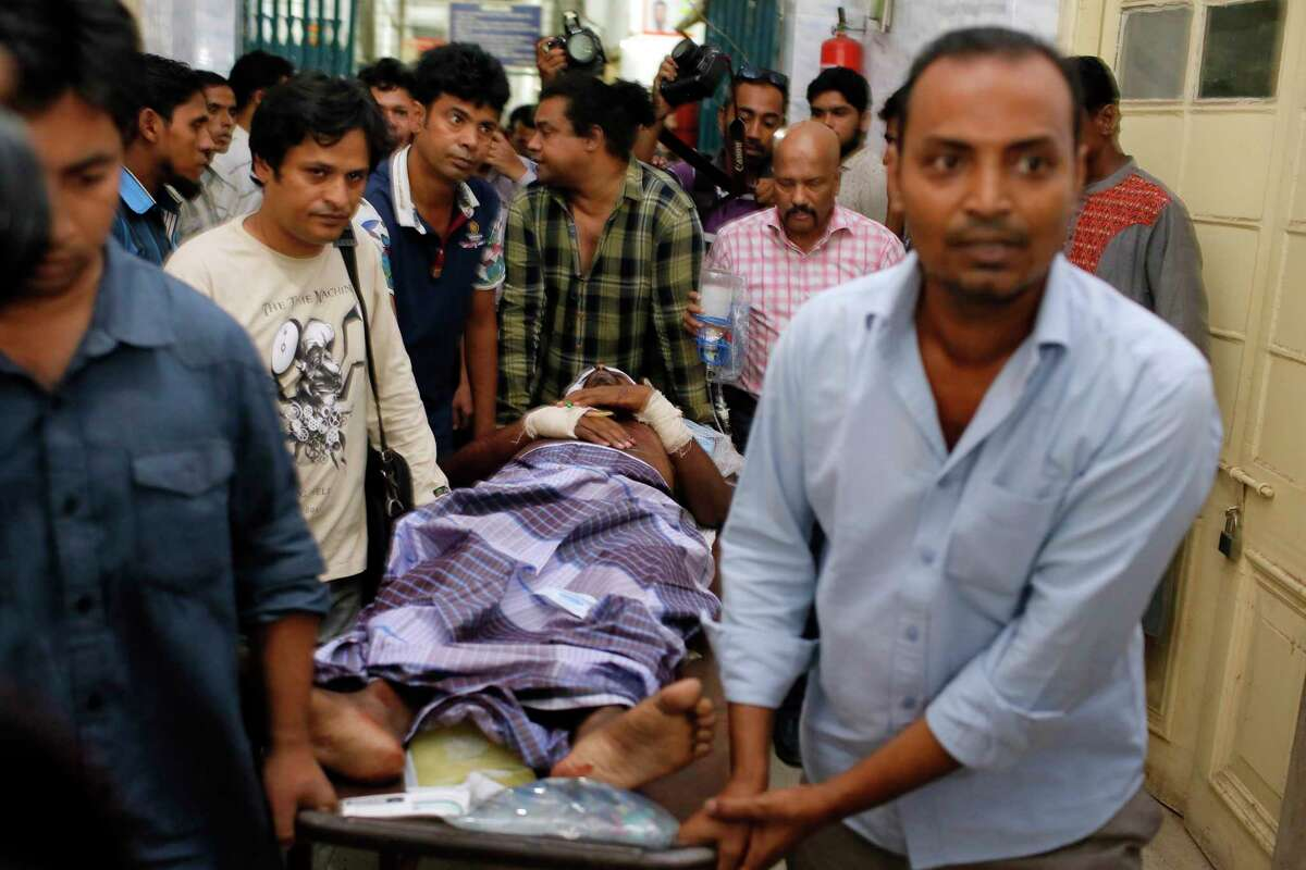 An injured publisher Ahmed Rahim Tutul is carried on a stretcher to the Dhaka Medical College Hospital in Dhaka, Bangladesh, Saturday, Oct. 31, 2015. A publisher of secular books was hacked to death and three other people, including Tutul, were wounded in two separate attacks Saturday at publishing houses in Bangladesh's capital, police said. The attacks in Dhaka come amid fears about the rise of radical Islam in Bangladesh.