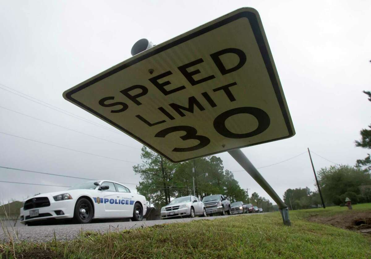 A speed limit sign is bent over to the ground in Friendswood, Texas, after a tornado reportedly touched down early Saturday, Oct. 31, 2015.