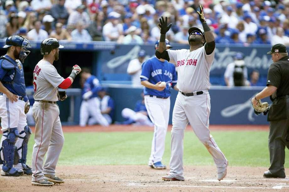 David Ortiz looks skyward following his three-run homer in the sixth inning on Sunday. Photo: Peter Power — The Canadian Press Via AP  / The Canadian Press