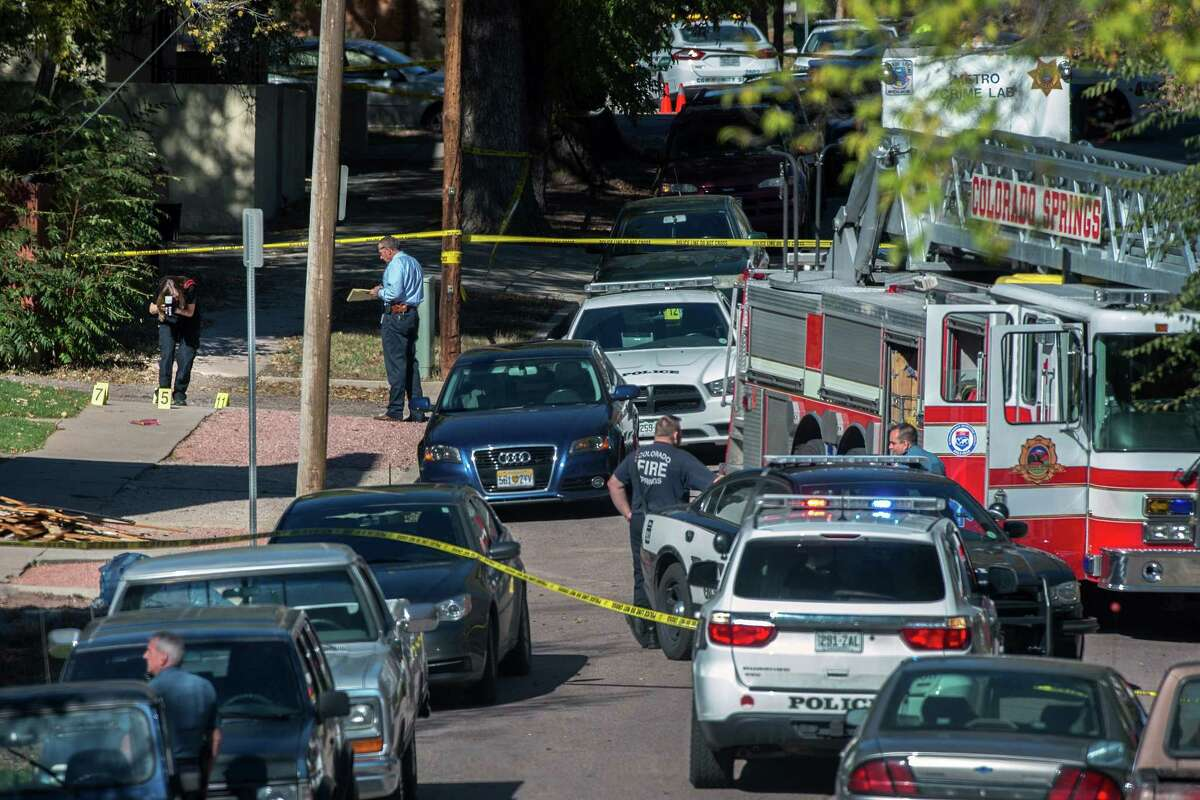 Police investigate the scene after a shooting Saturday, Oct. 31, 2015, in Colorado Springs, Colo. Multiple are dead, including a suspected gunman, following a shooting spree according to authorities. Lt. Catherine Buckley said the crime scene covers several major downtown streets.