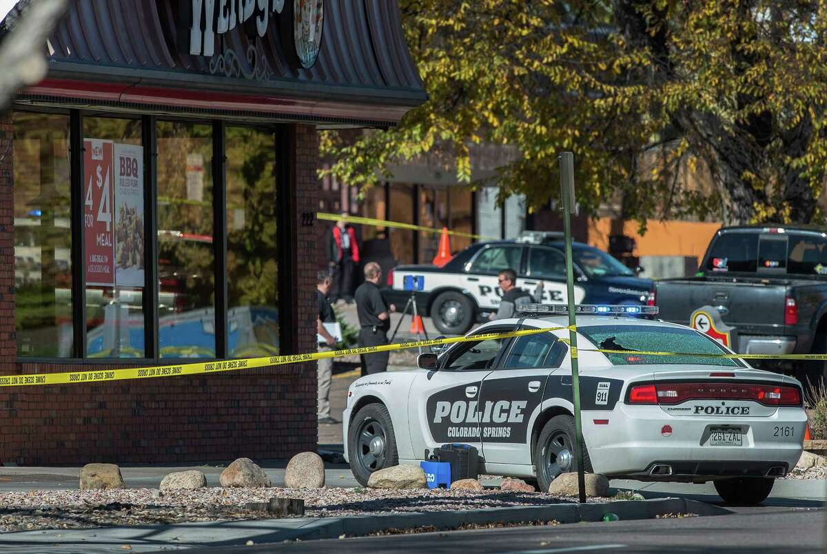 The rear window of a Colorado Springs Police car is shattered after a shooting Saturday, Oct. 31, 2015, in Colorado Springs, Colo. Multiple are dead, including a suspected gunman, following a shooting spree according to authorities. Lt. Catherine Buckley said the crime scene covers several major downtown streets.