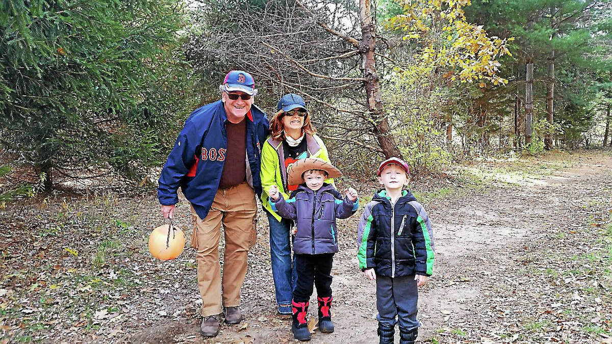Sean and Dinah Butterly of Watertown with their twin grandsons, Brody and Jack, both six years old, took a hike among 40 canine and human visitors who participated in the first annual Spooky Walk at the White Memorial Conservation Center at 80 Whitehall Road in Litchfield, on Saturday afternoon.
