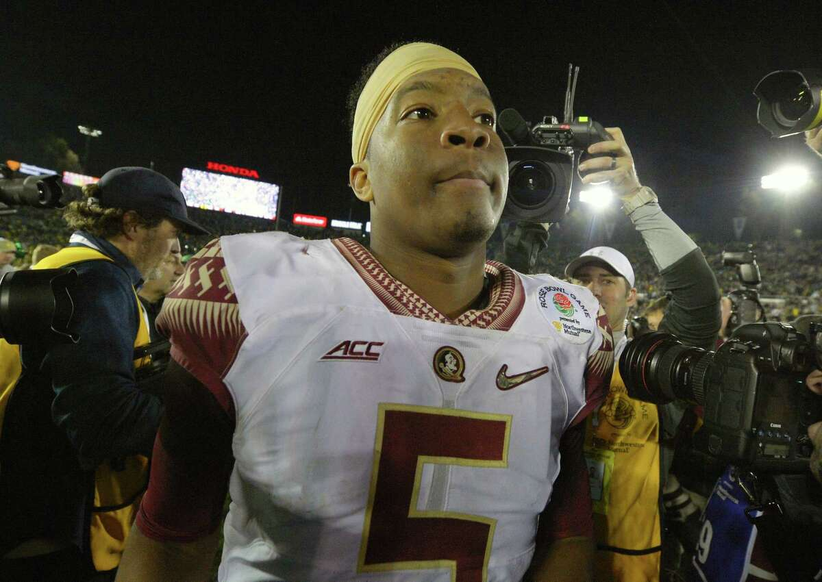 Florida State quarterback Jameis Winston walks off the field after the Seminoles' loss to Oregon in the Rose Bowl on Thursday in Pasadena, Calif.