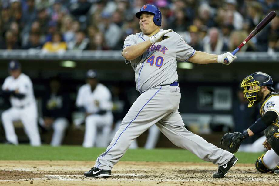 Bartolo Colon takes a swing during Saturday's game against the Padres. Photo: Gregory Bull — The Associated Press  / AP