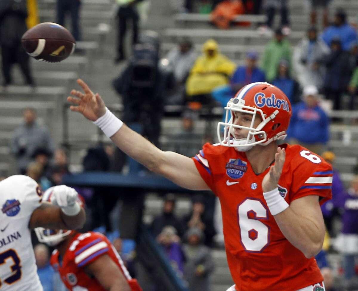 Florida quarterback Jeff Driskel throws a pass during the first half of the Birmingham Bowl against East Carolina on Saturday in Birmingham, Ala.