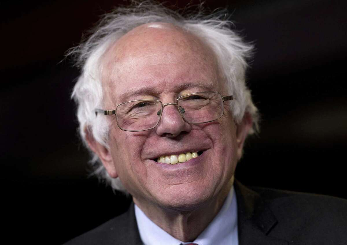 Sen. Bernie Sanders, I-Vt., smiles as he is asked about running for president during a news conference on Capitol Hill in Washington on April 29.