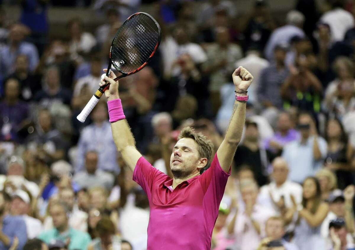 Stan Wawrinka reacts after beating Novak Djokovic to win the men's singles final at the U.S. Open on Sunday.